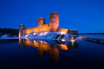View of Olavinlinna fortress in the March evening. Savonlinna, Finland