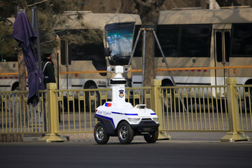 A police robot patrols before the third plenary session of the Chinese People's Political Consultative Conference (CPPCC) in Beijing