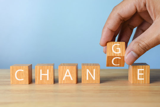 hand flip wooden cube with word change to chance career growth or change