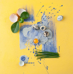 A modern combination of food shooting and contemporary art quail eggs and shnuk on an art background..