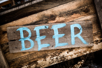 Beer sign on wooden board