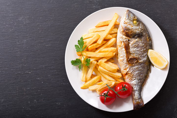 plate of baked fish with french fries