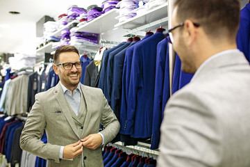 Smiling Young Man Buying a Shirt