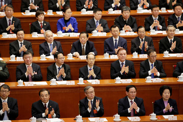 Delegates applaud after the parliament passed a constitutional amendment lifting presidential term limits, at the third plenary session of the National People's Congress (NPC) at the Great Hall of the People in Beijing