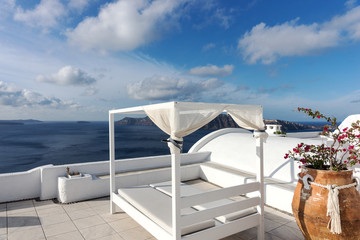 Relaxation zone on the terrace with sunbeds in Oia, Santorini