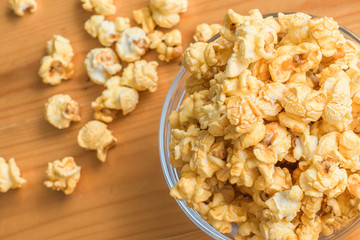Selective focus Popcorn on wooden table.