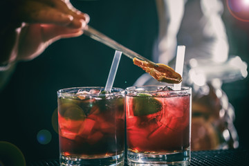 Red cocktail at bar counter