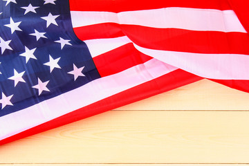 American Flag Over Whitewashed Wood Background For United States Holidays.