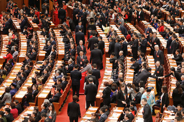 Delegates cast ballots during a vote on a constitutional amendment lifting presidential term limits, at the third plenary session of the National People's Congress (NPC) at the Great Hall of the People in Beijing