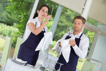 waiters setting the tables at gastronomy restaurant