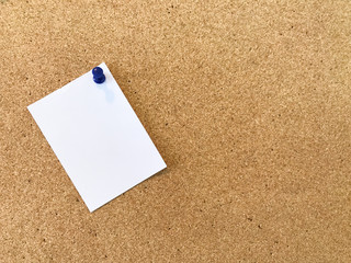 Blank white paper pin on cork board background for remind. Presenting a reminder concept Working in office