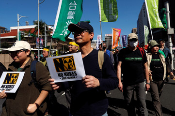 Demonstrators take part in a protest against nuclear power on the 7th anniversary of Japan's Fukushima nuclear disaster, in Taipei