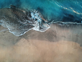 Aerial view of ocean waves and fantastic beach in the Canary Island