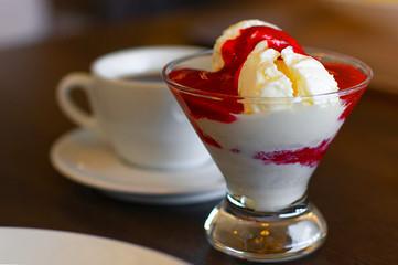 Strawberry vanilla ice cream and coffee on a backround.