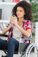 girl in the wheelchair holding a cup