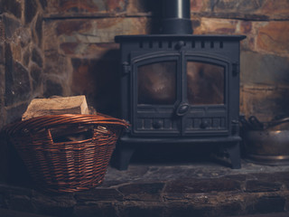 Log burner with basket of firewood