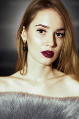 Glamour portrait of beautiful woman model with fresh makeup with dark pink lips color and clean healthy skin face