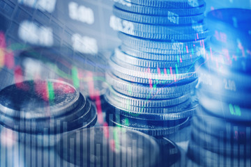 Graph on rows of coins for finance and banking on digital stock market financial exchange and Trading graph Double exposure city on the background