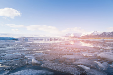 Beautiful Jokulsarlon glacier freezing ice lake, winter season natural landscape background