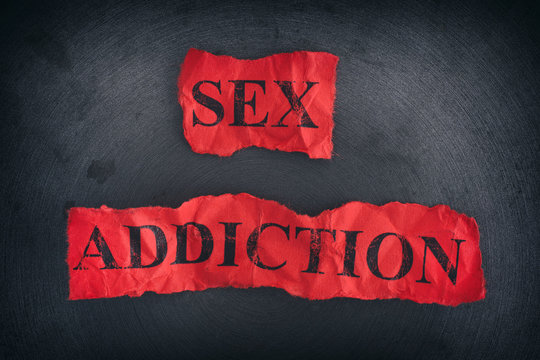 Crumpled pieces of paper with the words Sex Addiction