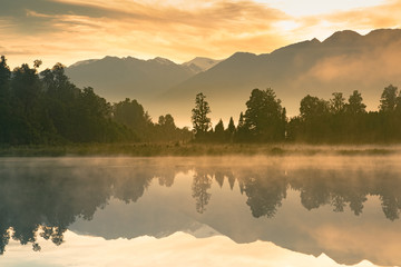 Beautiful mirror water Matheson lake in morning, New Zealand natural landscape background