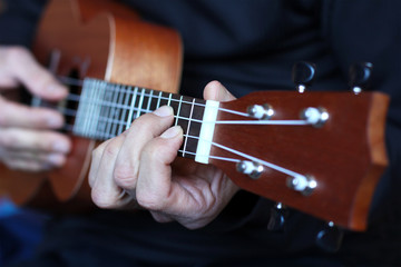 close up ukulele in musician hands
