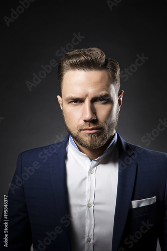 Handsome Young Man With Beard And Perfect Modern Hair Style Wearing