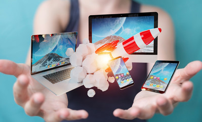 Businesswoman connecting tech devices and startup rocket 3D rendering
