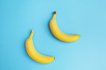 couple of bananas on blue background