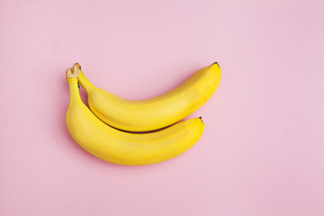 bananas on a pink background isolated