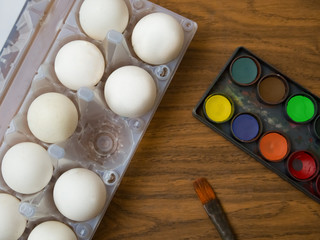 Eggs and paints, easter greeting card