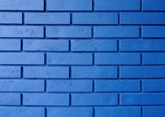 The brick wall is painted blue. Brick wall of blue color