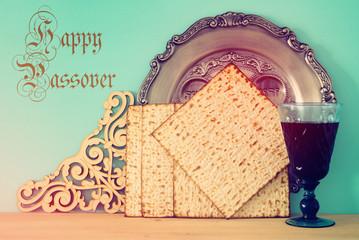 Pesah celebration concept (jewish Passover holiday). Translation for Hebrew Text: egg, bone.