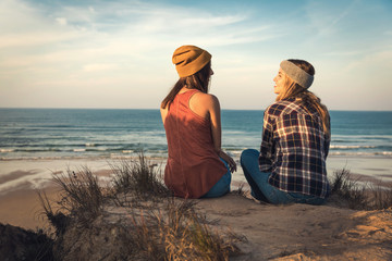 Girls sitting on the beach