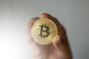 BITCOIN Gold Digital Currency cryptocurrency market.digital Holding money in hand