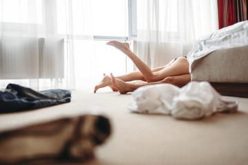 Legs sticking out from behind the bed, sex lovers
