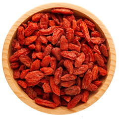 Goji berries in bowl isolated on white