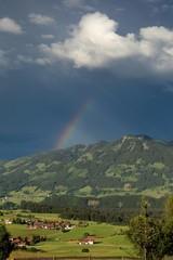 colorful rainbow and dark sky