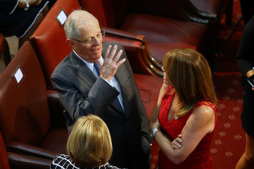Peru's President Kuczynski talks to Peru's Foreign Minister Aljovin at the inauguration ceremony of Chile's President-elect Sebastian Pinera at the Congress in Valparaiso