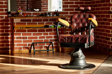 Retro leather chair barber shop in vintage style. Barbershop theme.