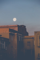 Moon over buildings