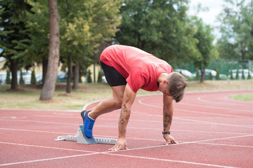 Man on Runway Athletics Track