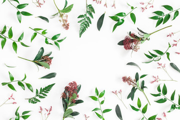Flowers composition. Frame made of tropical flowers and leaves on white background. Flat lay, top view, copy space