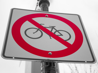 No bicycle sign with a grey sky on background