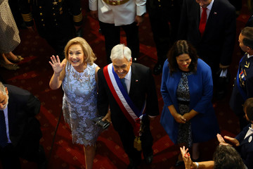 Chile's newly sworn in President Sebastian Pinera accompanied by his wife and first lady Cecilia Morel leaves the Congress in Valparaiso
