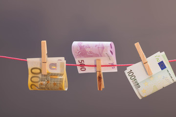 Euro  banknotes hanging from  clothesline