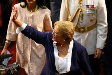 Chile's former President Michelle Bachelet leaves the Congress after the inauguration ceremony of Chile's newly sworn in President Sebastian Pinera in Valparaiso
