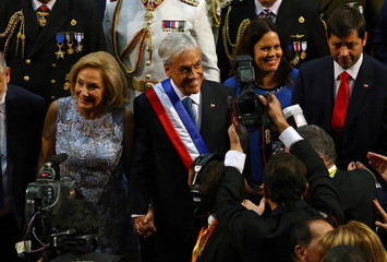 Chile's newly sworn-in President Sebastian Pinera and his wife and first lady Cecilia Morel leave the Congress in Valparaiso