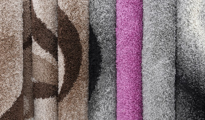 Carpets variety selection rolled up rugs shop store lot