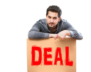 A man with a serious gaze pointing his finger on a deal marketing sign, perfect for advertising, promotion, banner